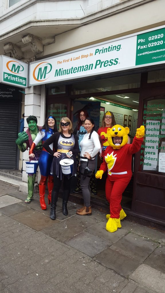 The Minuteman Press and New Link Wales teams dressed as superheroes as part of an event run by New Link Wales, which ran a 'Heroine Day Event' that raised awareness of those recovering from substance misuse and the struggles as well as the stigmatism they encounter.