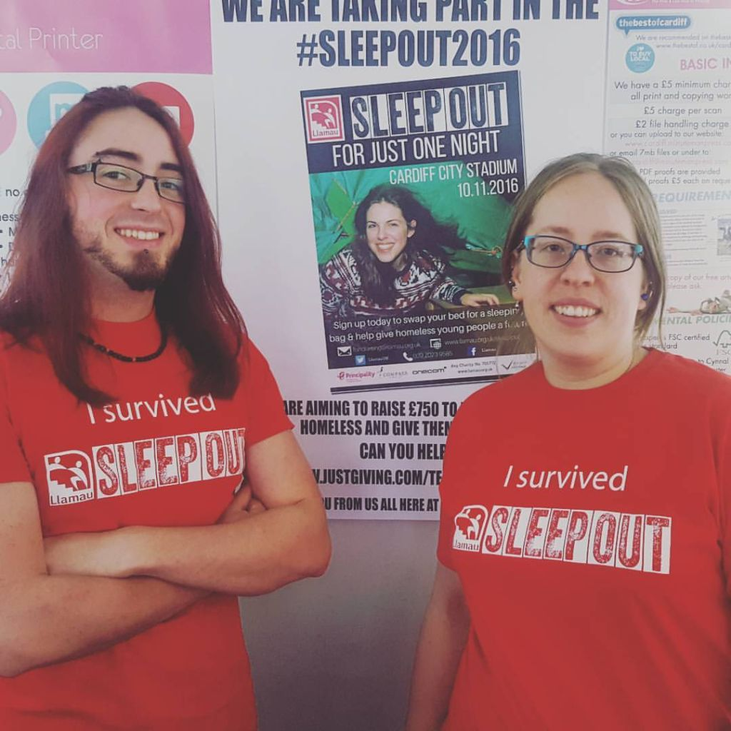 """Team members of Minuteman Press in Cardiff proudly display their """"I survived SLEEPOUT"""" T-Shirts following their participation in Llamau Sleep Out 2016, which raised money and awareness about the young homeless in Cardiff."""